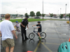 Officer Talks with Community Members Next to Bikes