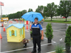 Officer With Umbrella Next to Course