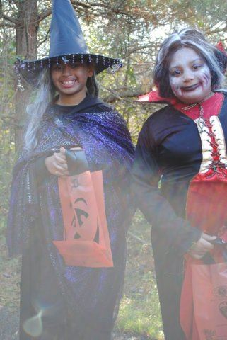 Young Girls Wear Witch Costumes