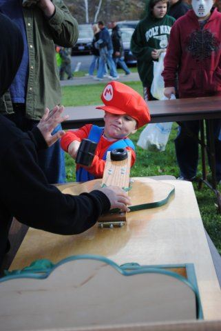 Young Mario Prepares to Hit Game with Toy Hammer