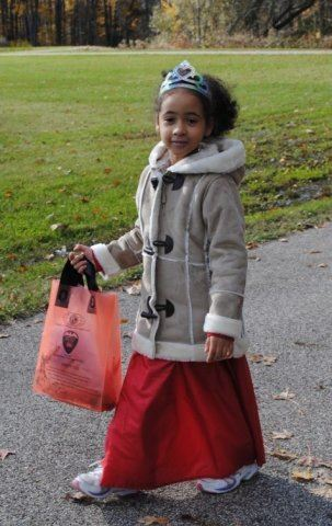 Young Princess Holds Candy Bag