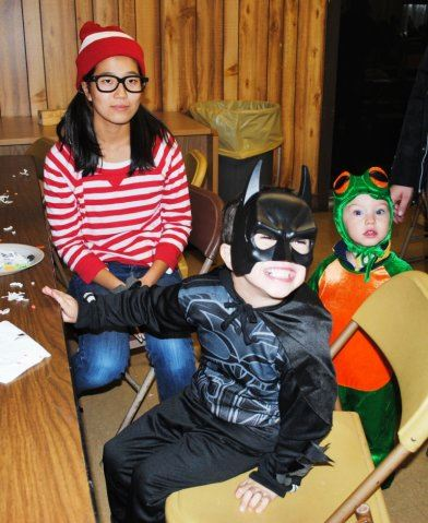 Volunteer and Children Smile In Their Costumes