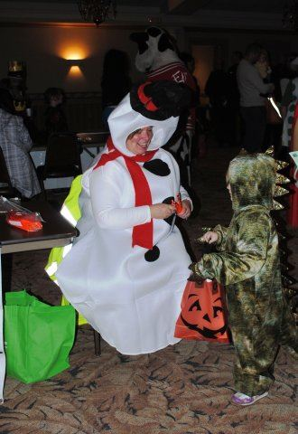 Volunteer Giving Out Candy in Costume