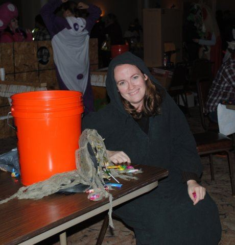 Volunteer in Costume Next to Table