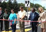 Community Leaders Cutting a Ribbon on a Street