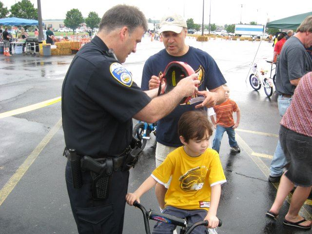 Community Member and Officer Talking About Helmet