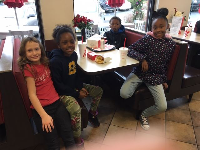Four young children at Chick fil A
