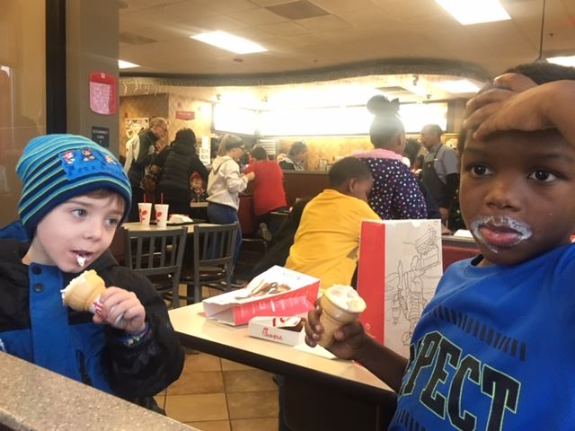 Two young boys eating ice cream