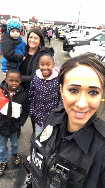 Officer Shendy with mother and children