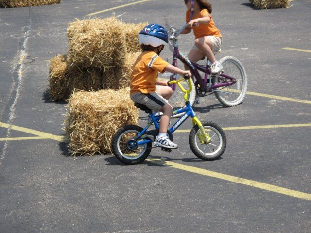 Young Child Rides Around Hay Bale