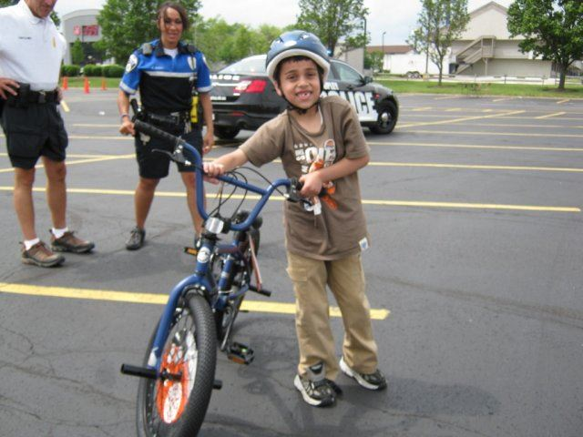 Young Boy Standing With His Bike