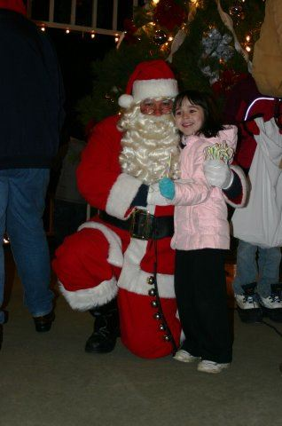 Santa Kneels With Young Girl