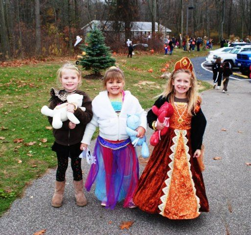 Young Girls in Costume Smile For Camera