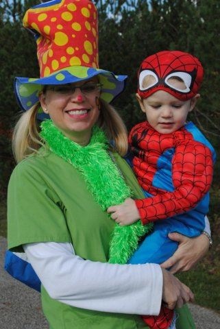 Mother Holds Boy in Costume