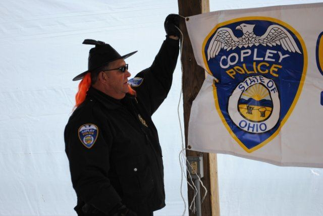 Officer Hangs Banner