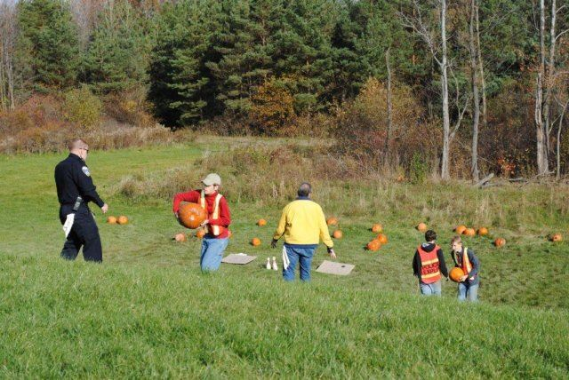 Officers Relay Pumpkins Back Up The Hill