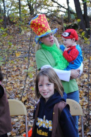 Woman Holds Boy in Spider Man Costume