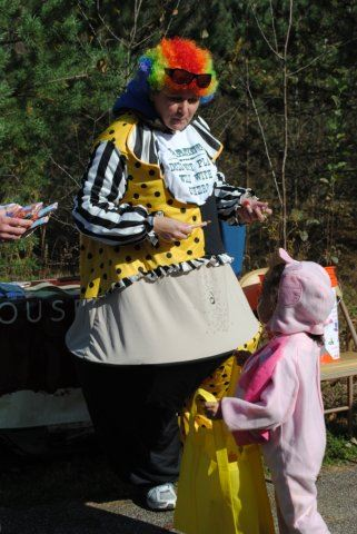 Woman in Costume Gives Out Candy