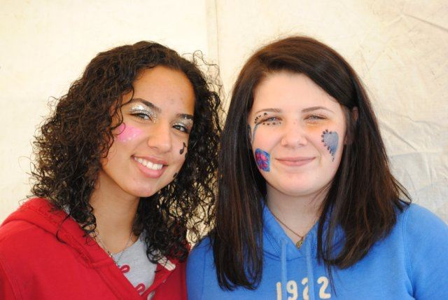 Women Smile Together With Face Painted
