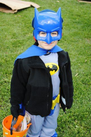 Young Batman Smiles for Camera