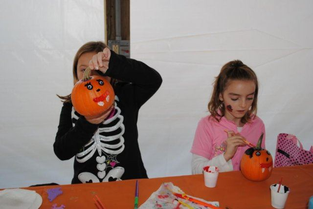 Young Children Paint Pumpkins
