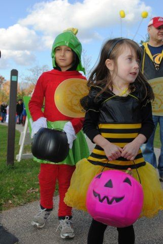 Young Children Wear Costumes and Hold Candy