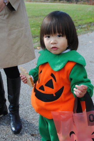 Young Girl in Pumpkin Costume