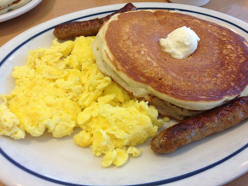 pancakes and eggs and sausage image
